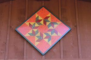 #1-12 Swirling Leaves adorns the Nichols residence, a gift from Donna's mother, a prolific barn quilt painter.
