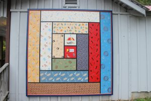 #1-09 Log Cabin quilt block is found on the General Store building at the foot of the mountain at the Ozark Folk Center State Park.
